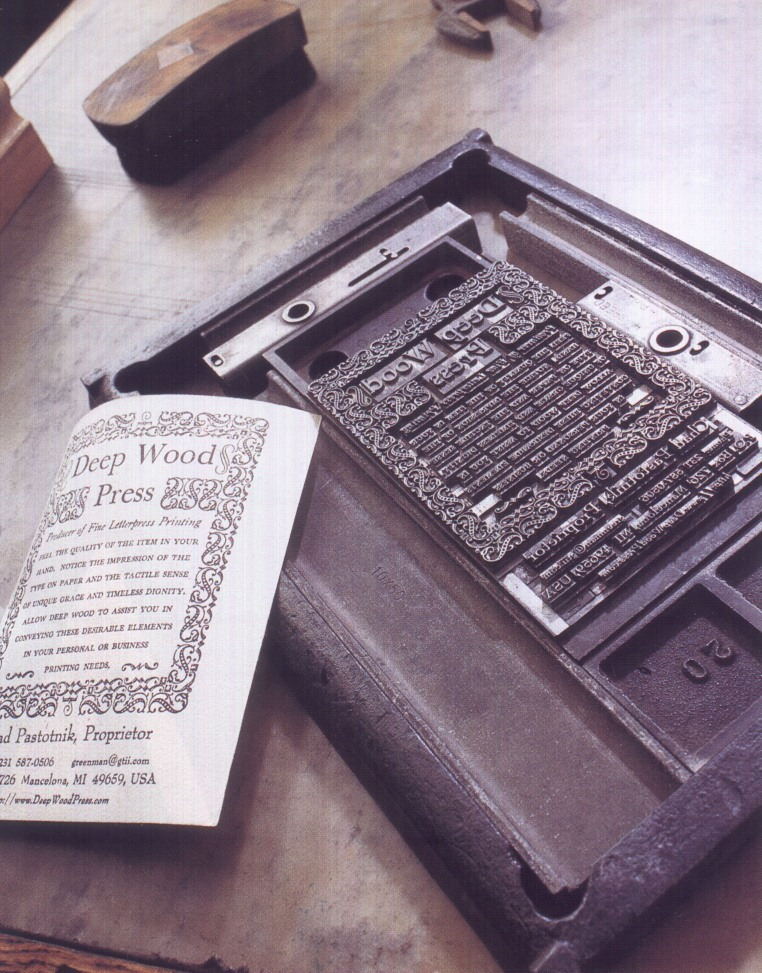 Hand set type and border material for Deep Wood Press promotional item.