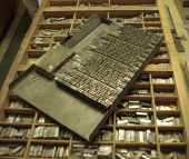 The wood engraving and part of the type set up on the galley.